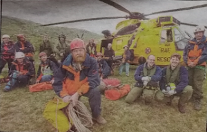 The OVMRO team with the type of helicopter used in Andy's rescue